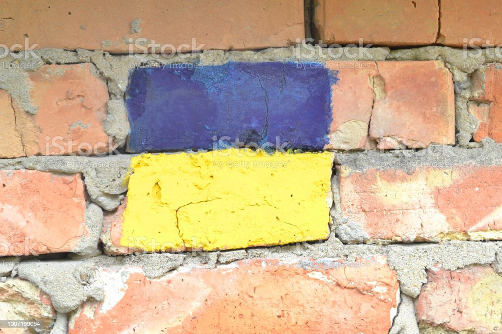 Flag of Ukraine on a brick wall. stock photo