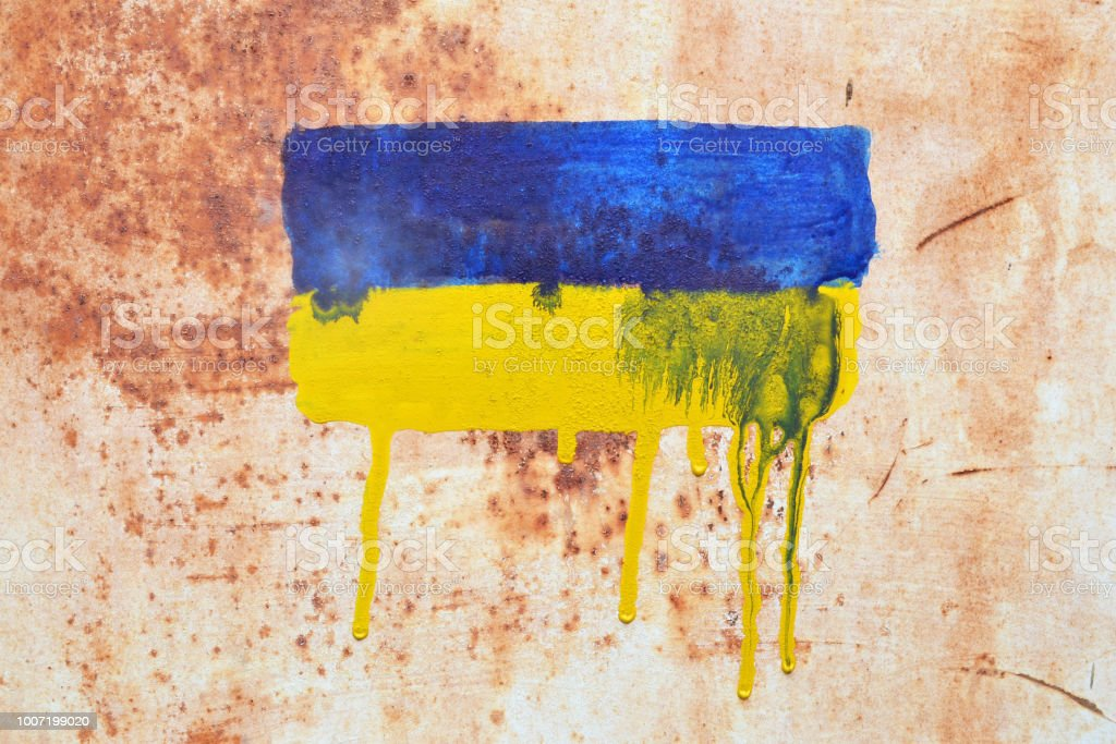 Flag of Ukraine with stains of paint stock photo