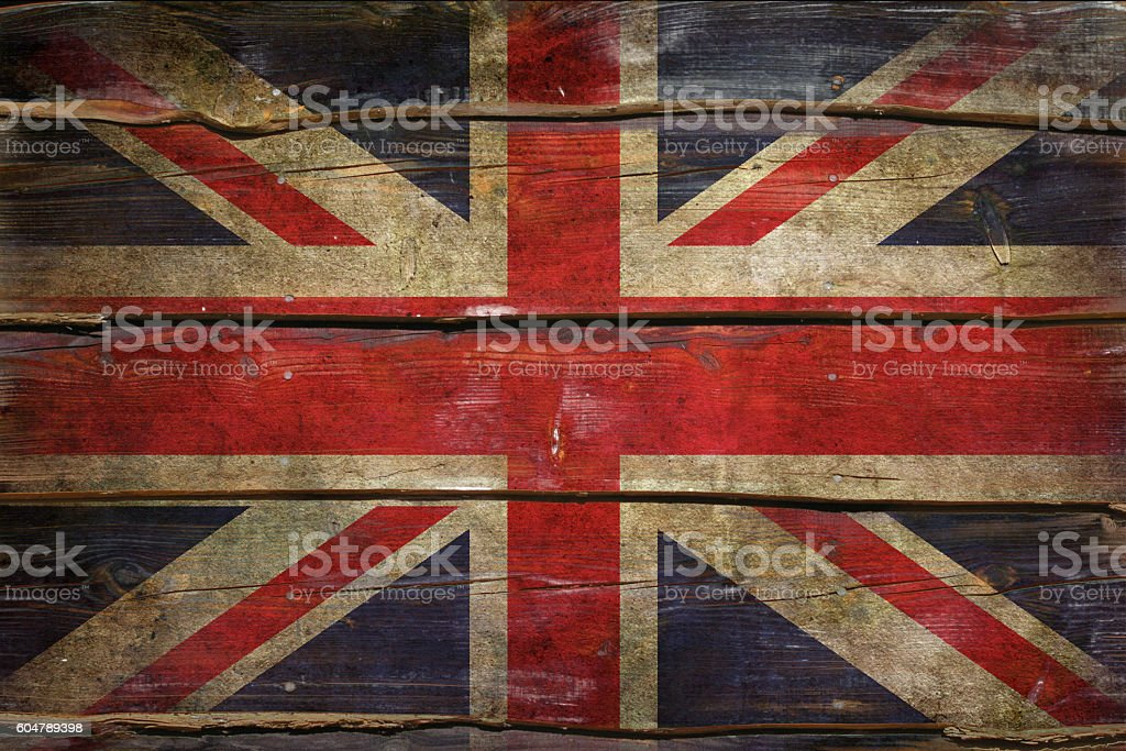 Flag of United Kingdom painted on a grunge plank. stock photo