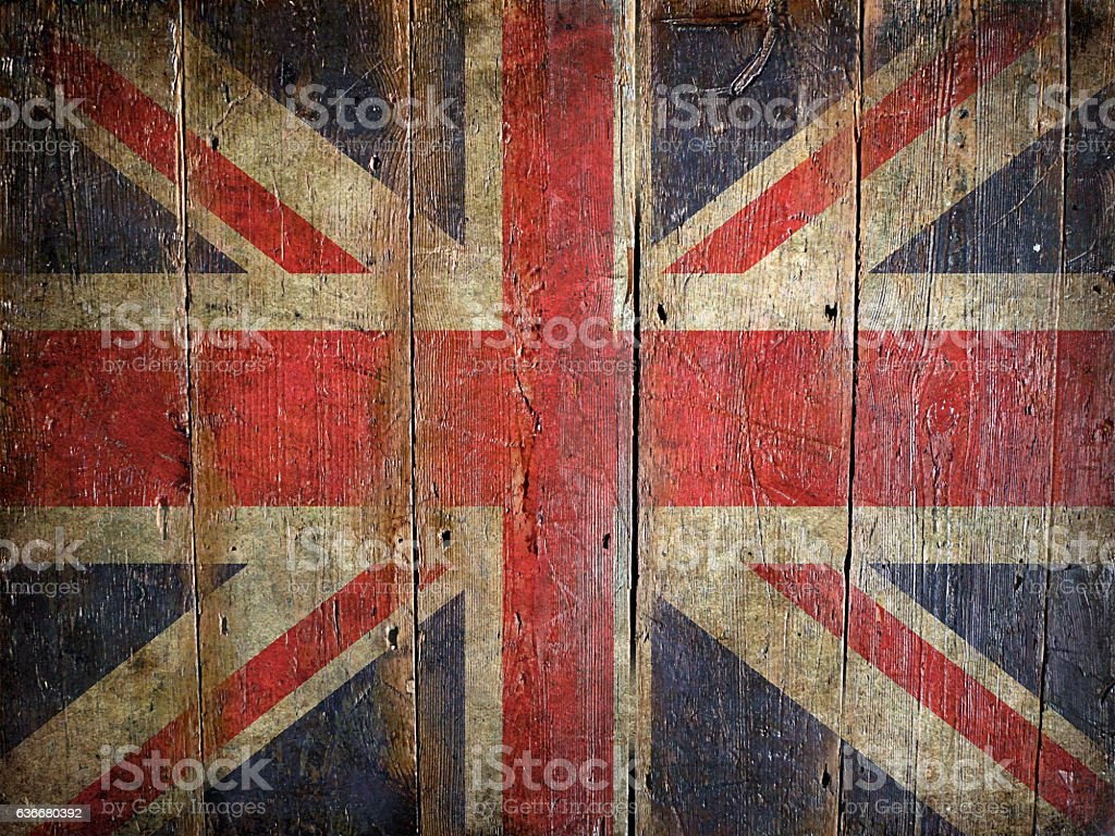 Flag of United Kingdom painted on a grunge plank stock photo