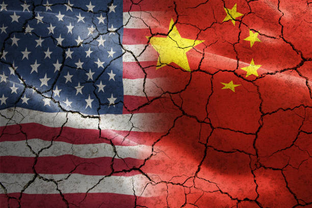 Flag of United States of America against China in cracked texture - indicates negative impact and conflict between these two countries such as international economy, trade war, partnership . Flag of United States of America against China in cracked texture - indicates negative impact and conflict between these two countries such as international economy, trade war, partnership trade war stock pictures, royalty-free photos & images