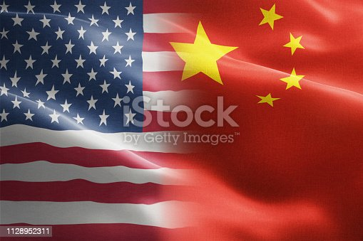 istock Flag of United States of America against China - indicates partnership, agreement, or trade wall and conflict between these two countries 1128952311