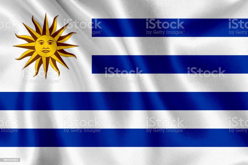 Bandera de Uruguay que agita el fondo - foto de stock