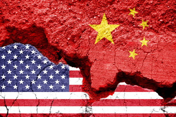 Flag of USA and China on a cracked background. Concept of crisis between two nations, Washington and Beijing Flag of USA and China on a cracked background. Concept of crisis between two nations, Washington and Beijing major military rank stock pictures, royalty-free photos & images