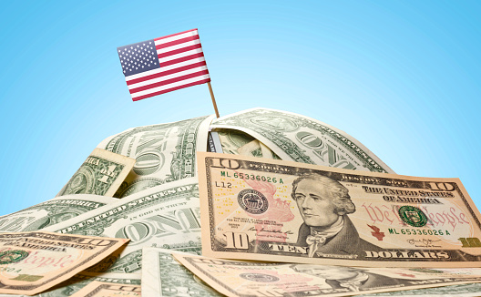 Flag of USA sticking in american banknotes.(series)