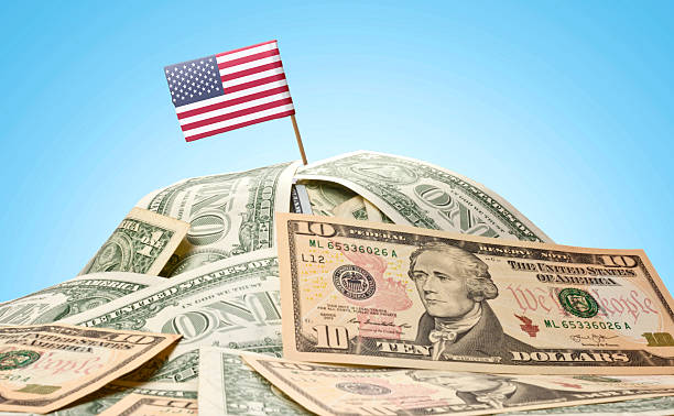 Flag of USA sticking in american banknotes.(series) stock photo