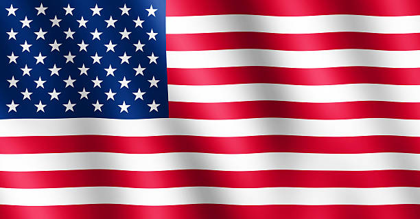 Flag of USA waving in the wind stock photo