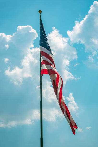 Flag of USA with sky background stock photo