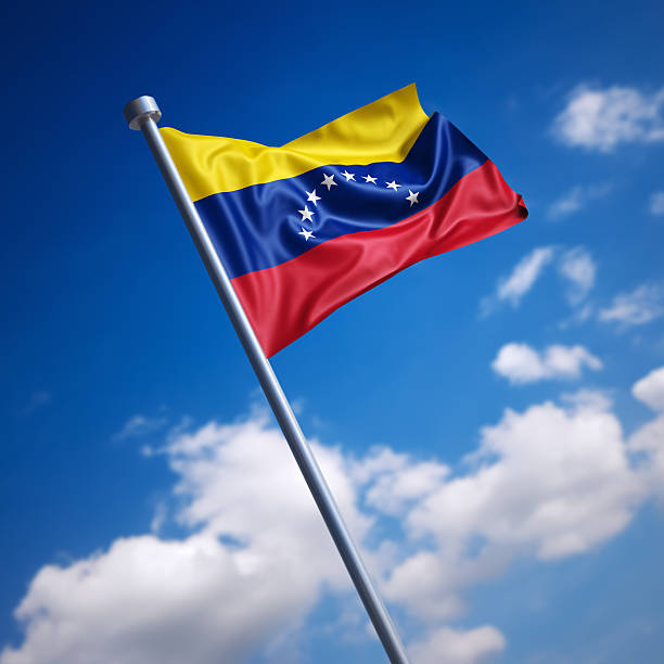 flag of venezuela against blue sky. - venezuelan flag stock photos and pictures