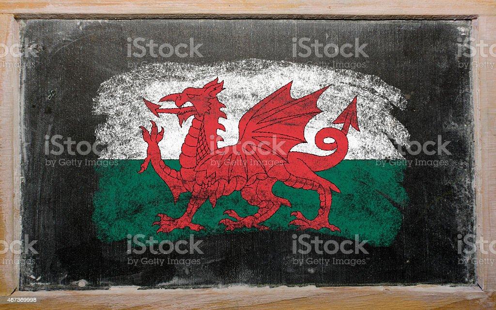 flag of wales on black blackboard stock photo