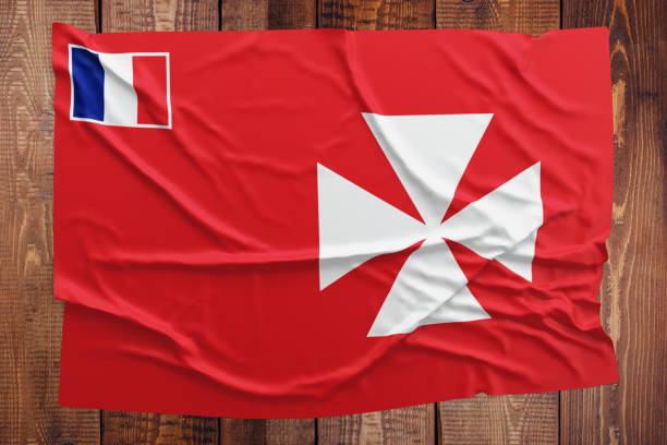 Flag of Wallis And Futuna on a wooden table background. Wrinkled flag top view. stock photo