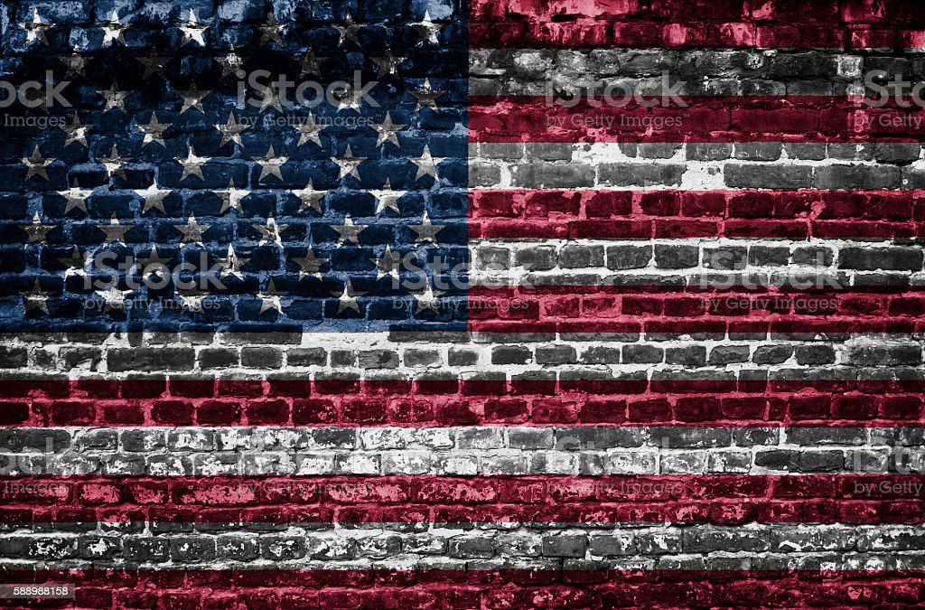 USA flag on brick wall background stock photo