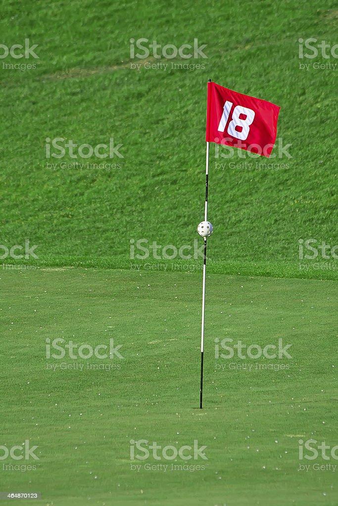 flag on golf course stock photo