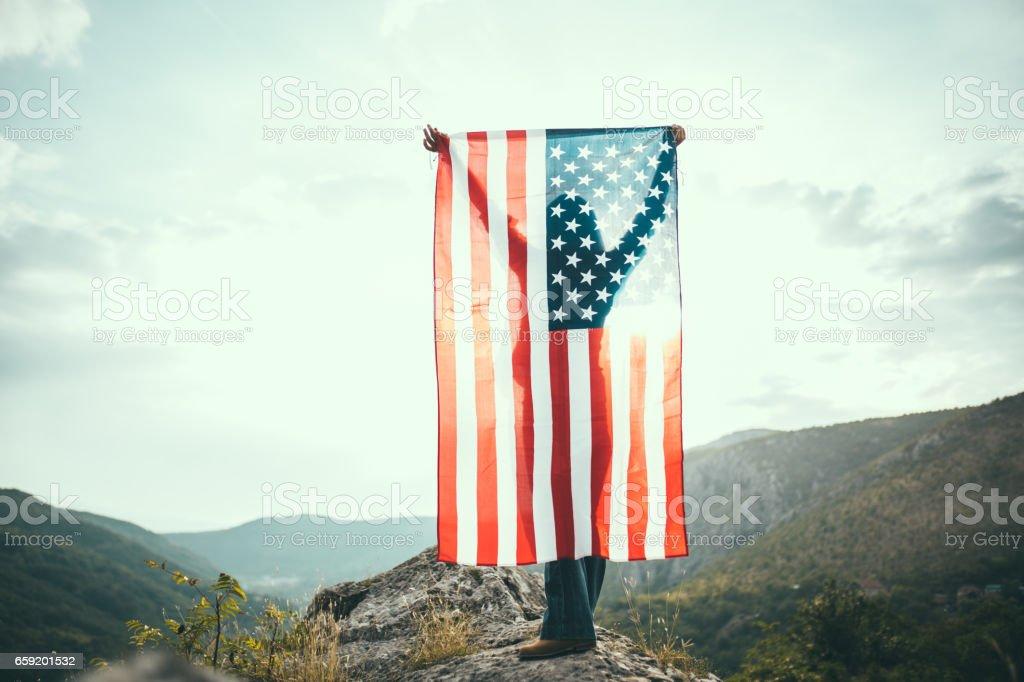 US flag on mountain stock photo