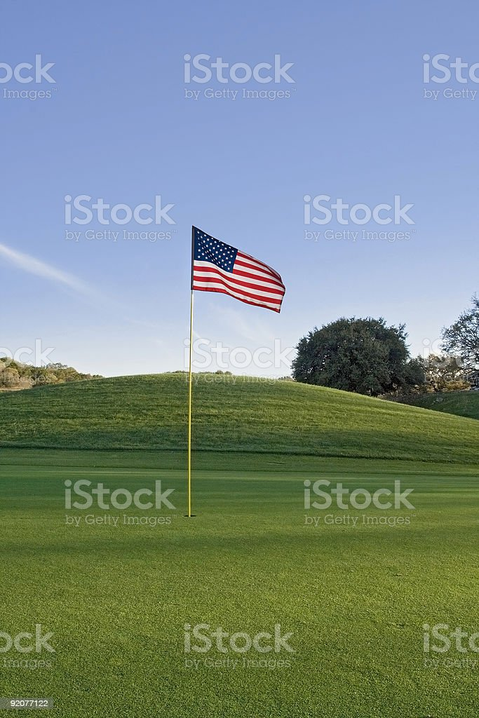 US flag on putting green stock photo