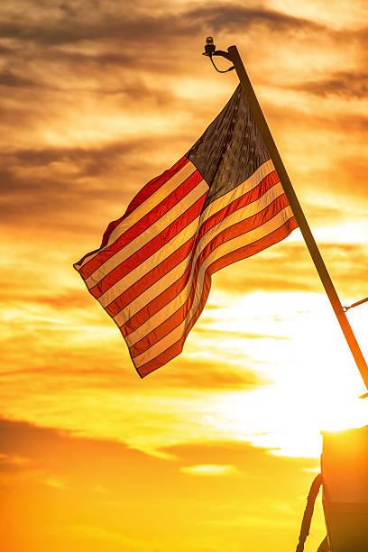 US flag on sunset stock photo