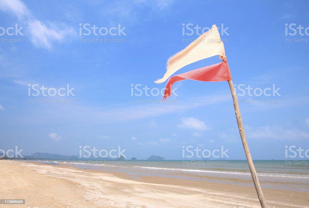 flag on the beach stock photo