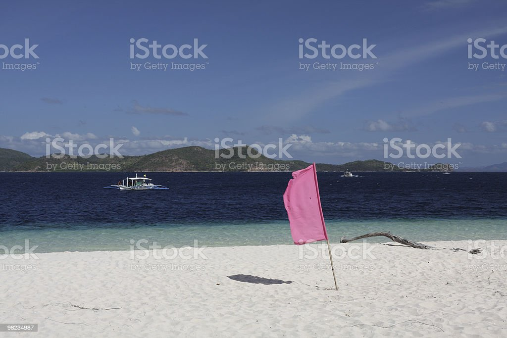 Flag on the tropical beach royalty-free stock photo
