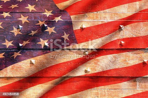182764873istockphoto USA flag on wood texture 492484858