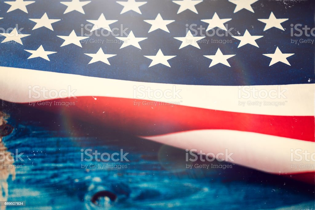 US Flag on Wooden Table stock photo