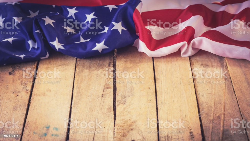 USA flag on wooden wall background and texture with space stock photo