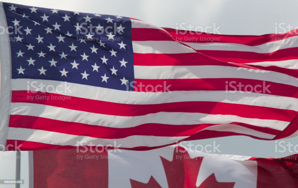 USA flag over canada united states country north america stock photo