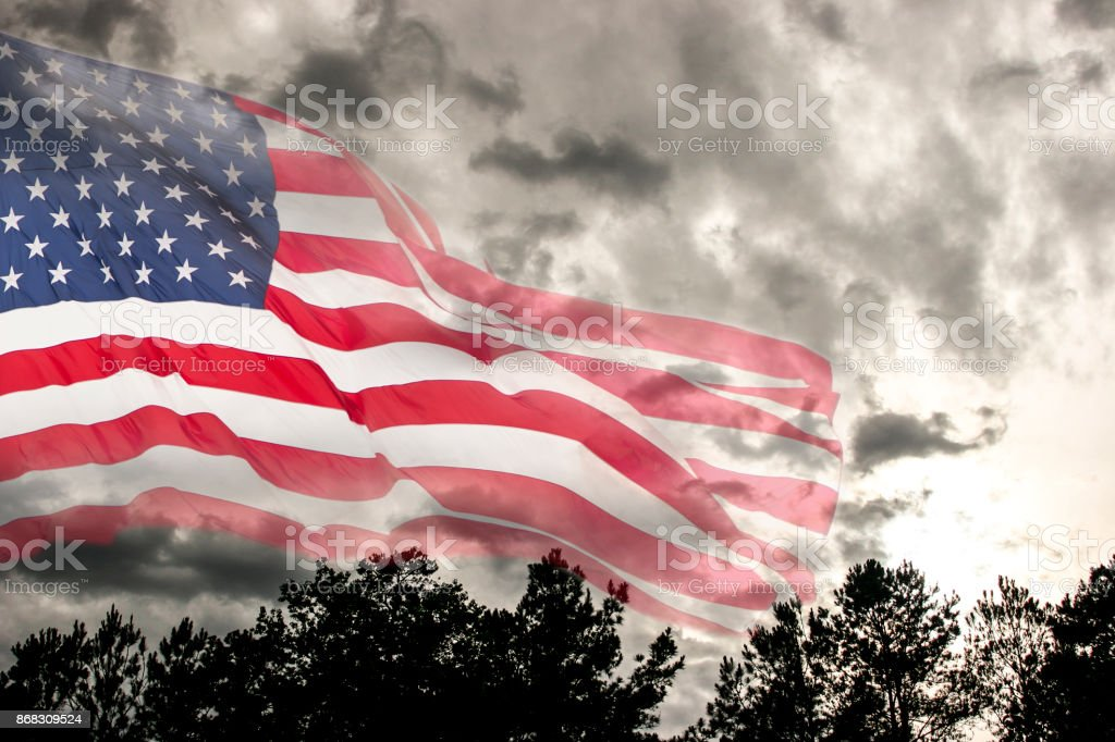 Usa Flag Overlay On Dark Cloudy Stormy Sky With Tree