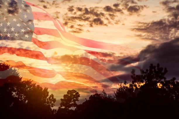 USA flag overlay on dramatic sunset sky. stock photo