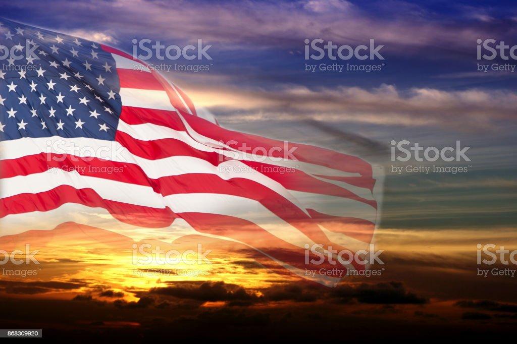 USA flag overlay on sunset sky. stock photo