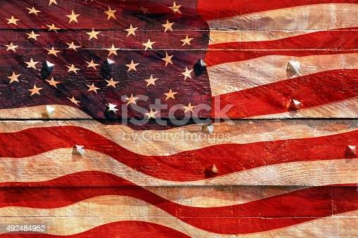 182764873istockphoto USA flag painted on wood background 492484952