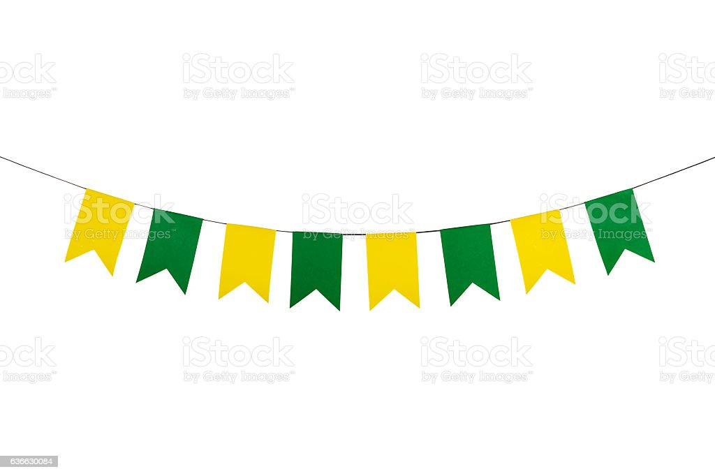 Flag papers yellow and green hanging on the rope. stock photo