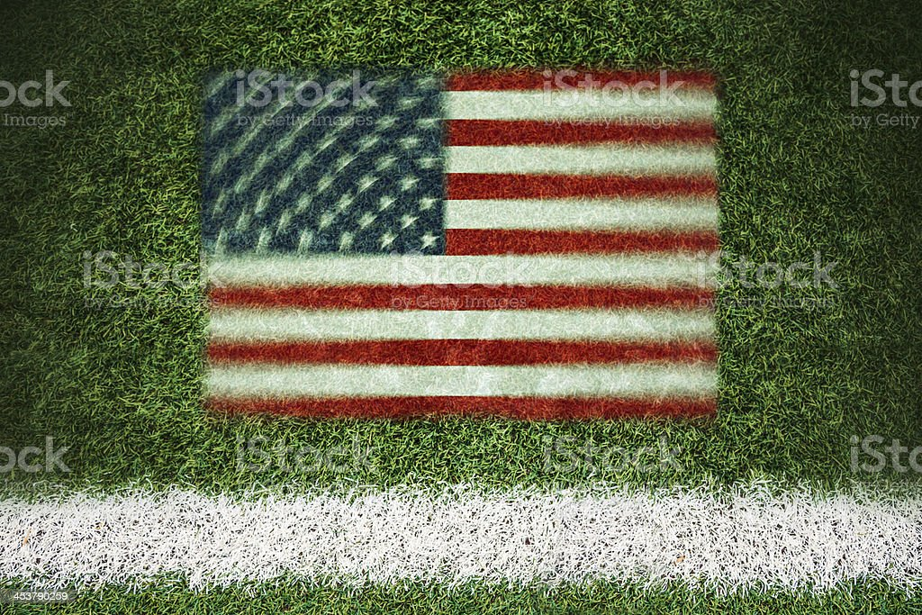 USA flag printed on a soccer field stock photo