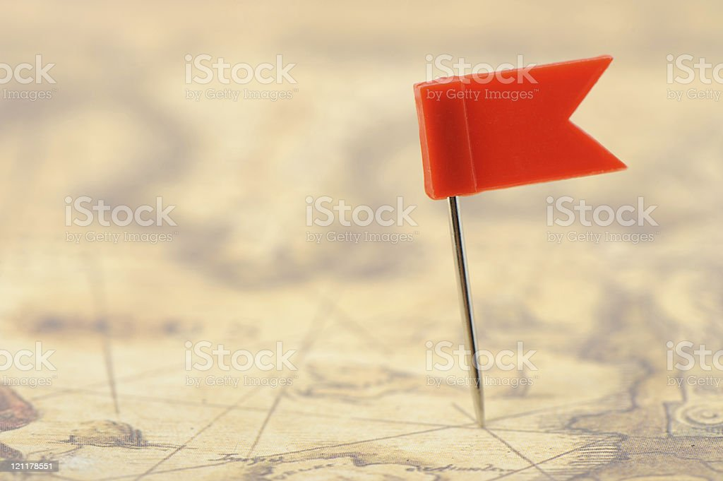 Flag red a pin on old map stock photo