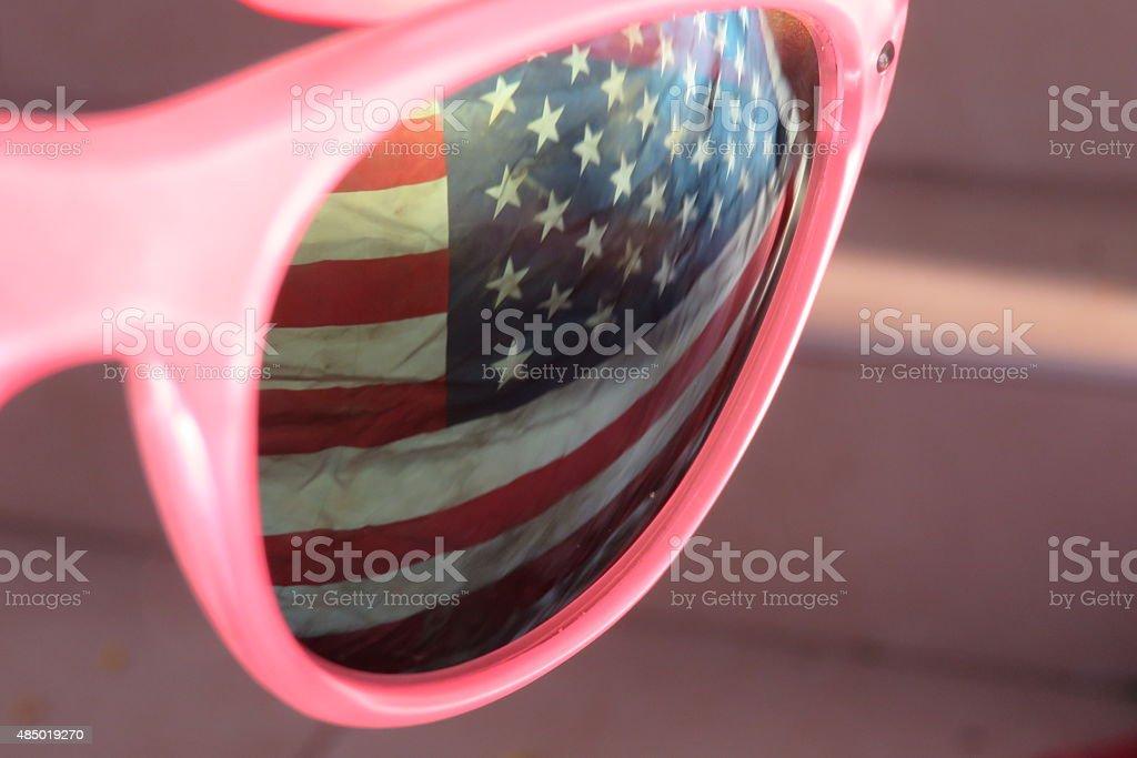 US flag reflected on glasses stock photo