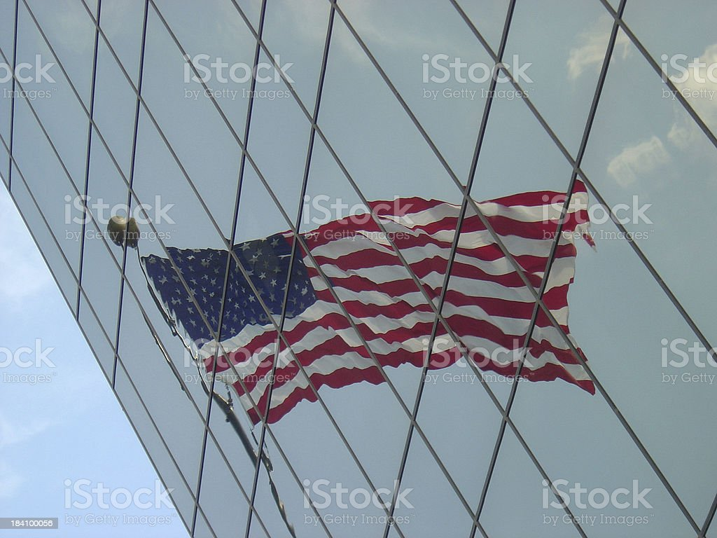 Flag Reflecting in an angled office building royalty-free stock photo