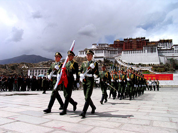 flag rising in lhasa, tibet - chinese military bildbanksfoton och bilder