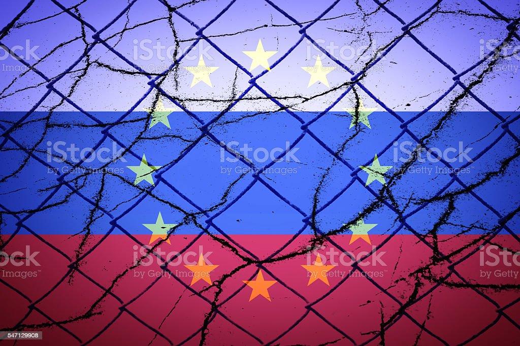 EU flag, Russian flag and cracks stock photo