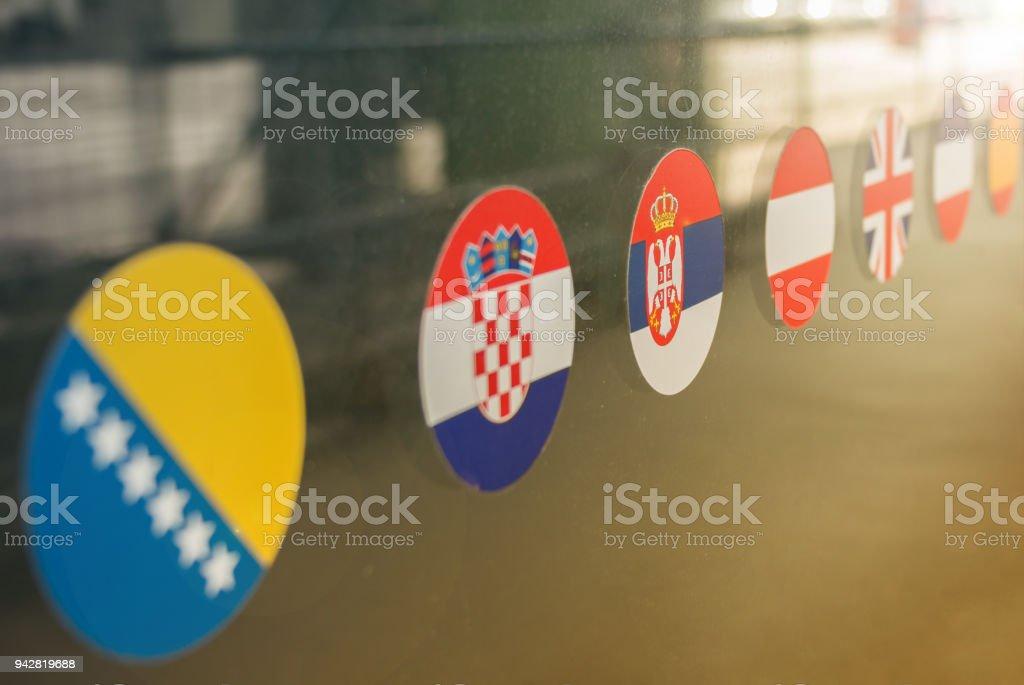 Flag stickers on window stock photo