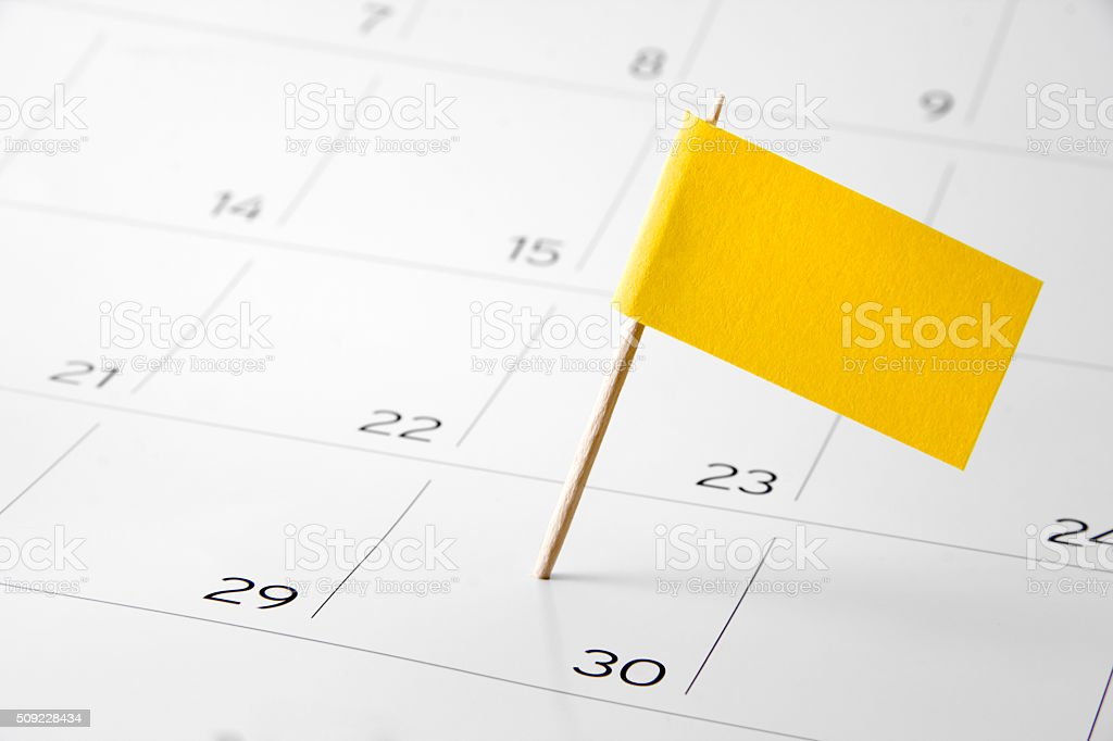 Flag the event day or deadline on calendar 2016 stock photo