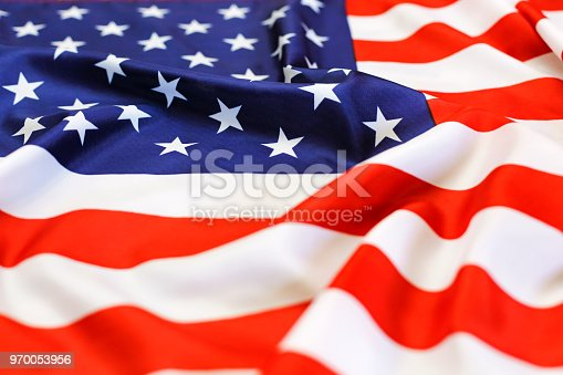 istock flag USA, national symbol, independence Day. patriotic, waving, close up 970053956