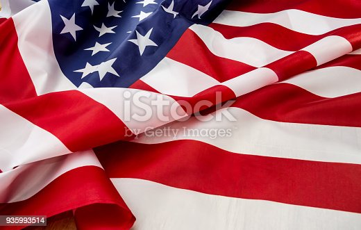 937074172 istock photo flag USA with wave close up 935993514