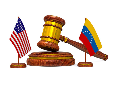 istock flag Venezuela and USA and wooden gavel on white background. Isolated 3D illustration 1133575995