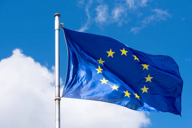 EU Flag waving against blue Sky EU Flag waving against blue Sky european currency stock pictures, royalty-free photos & images