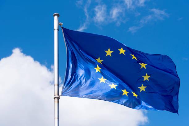 EU Flag waving against blue Sky stock photo