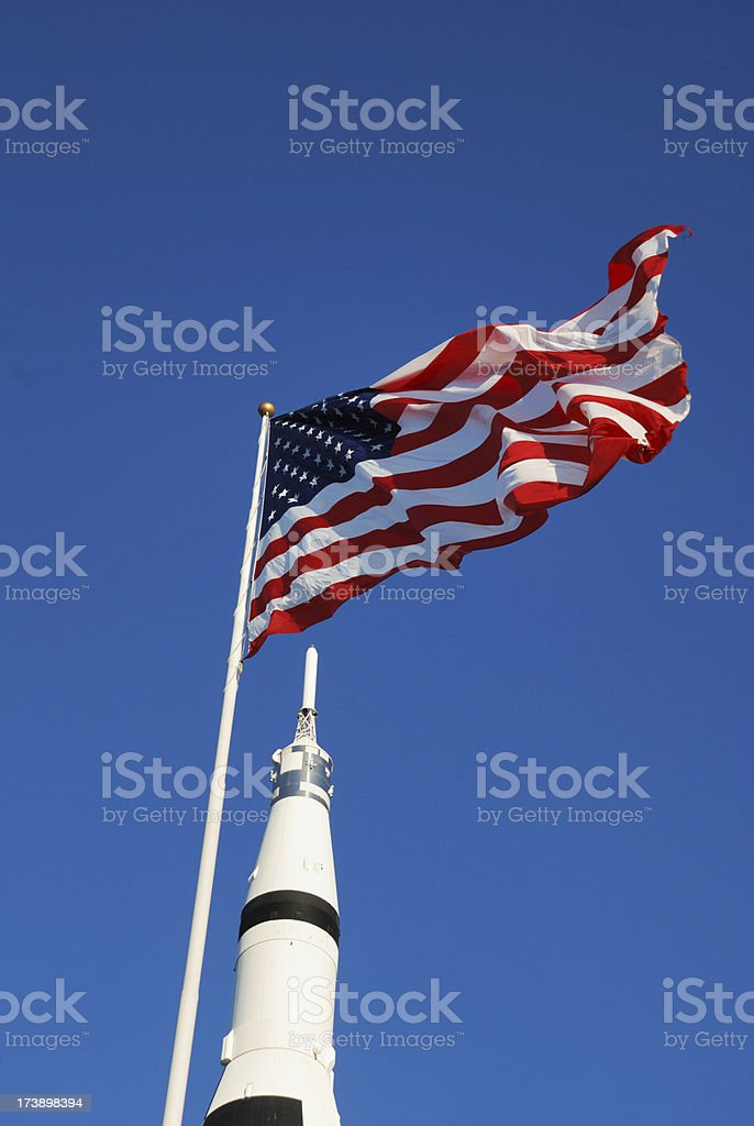 Flag waving over rocket stock photo