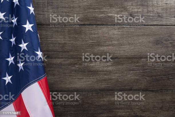 Flag with embossed stars hanged against old wooden wall background picture id1177174481?b=1&k=6&m=1177174481&s=612x612&h=5as4ojlalf kilncr5ltxzwggyfywzwdfpt9vkorh10=