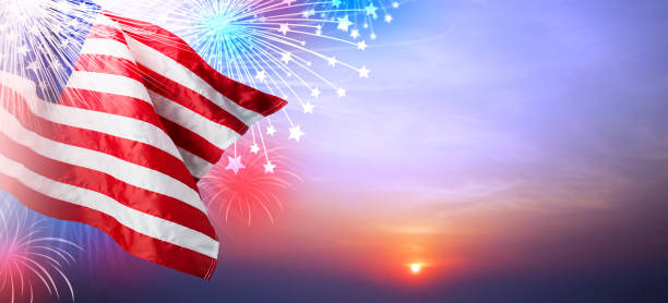 usa flag with firework at sunset background - fourth of july стоковые фото и изображения