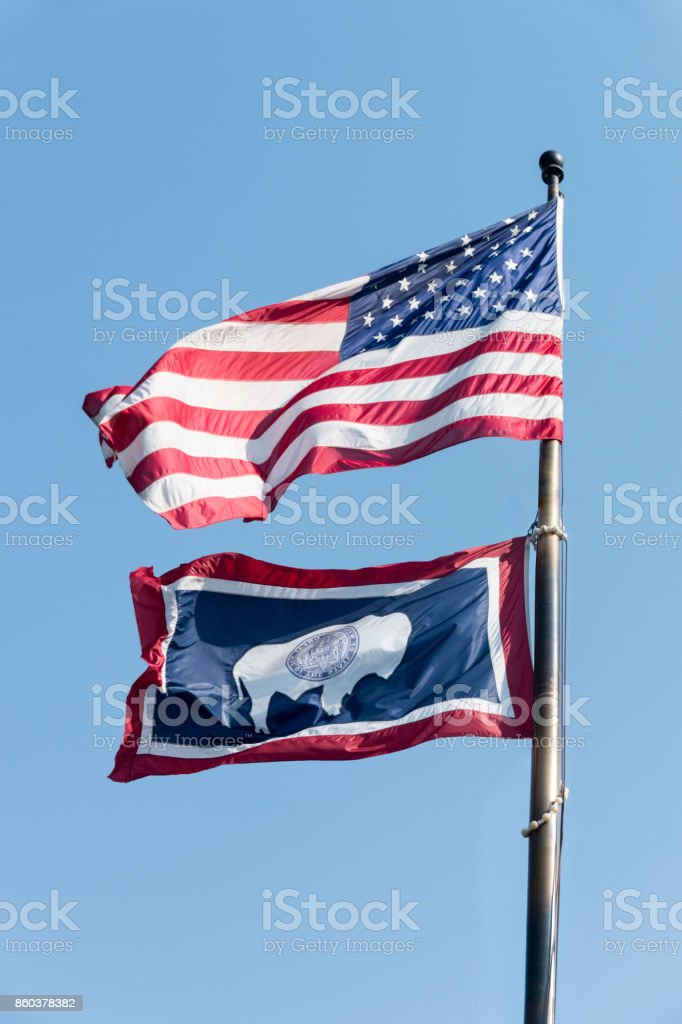 USA flag with flag of Wyomin stock photo