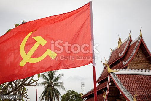 Red flag with hammer and sickle outside a temple in Luang Prabang, the former capital of Laos