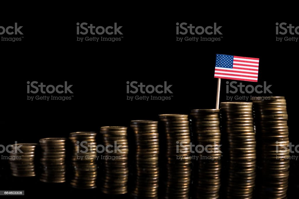 USA flag with lot of coins isolated on black background stock photo